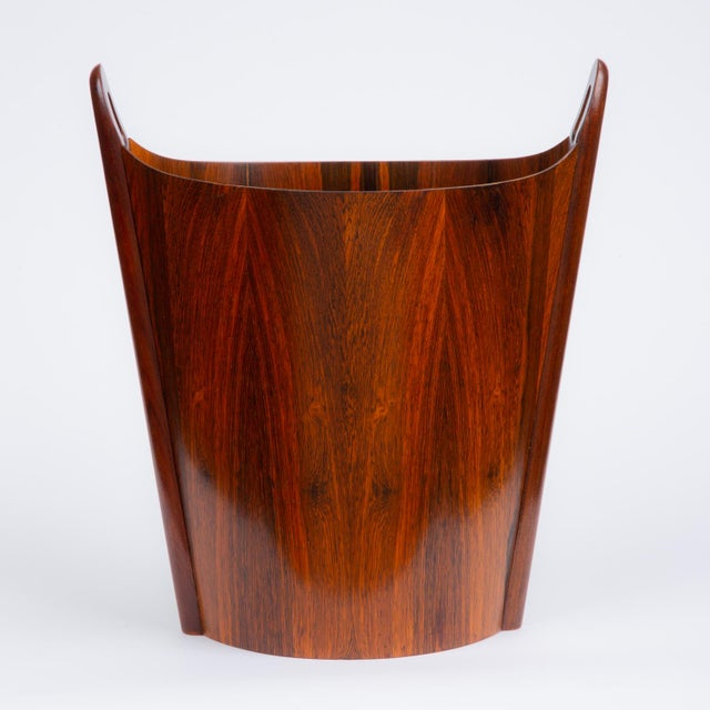 A wastebasket with delicate construction in subtly figured rosewood, designed and produced in Norway by Einar Barnes for...