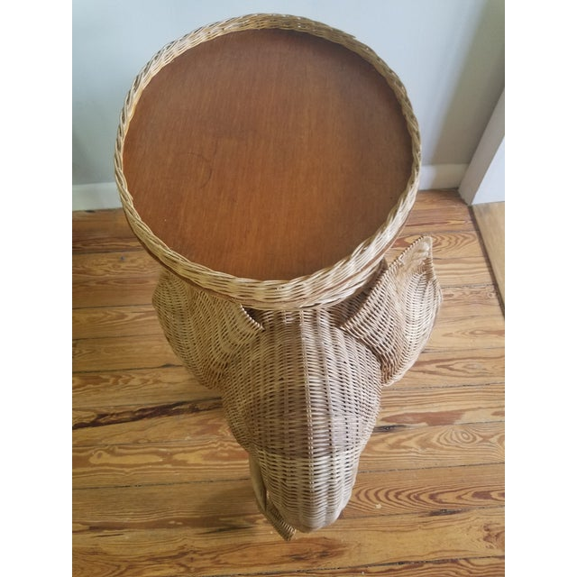 Market found, I love the natural wicker detailed weave of this elephant side table with a removable tray top. Marked...
