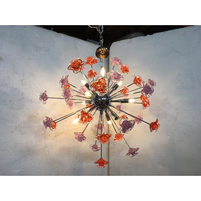 Contemporary Murano glass flowers sputnik chandelier with red and violet flowers and a chrome colored metal frame. The...