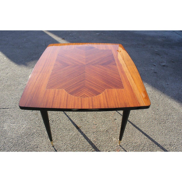 Beautiful French art deco exotic macassar ebony center table or dining table circa 1940s. The table are in perfect...