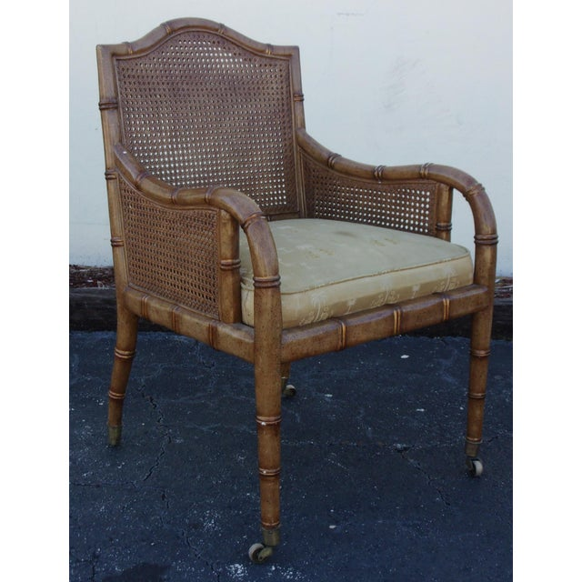 "Vintage faux bamboo & cane chair with upholstered seat cushion. 18"" Seat Height. Minor wear, stain to textile."