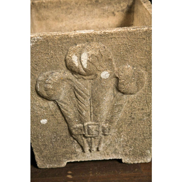 """Pair of cast stone planters decorated with Prince of Wales plumes on one side. Base is 11"""" square."""