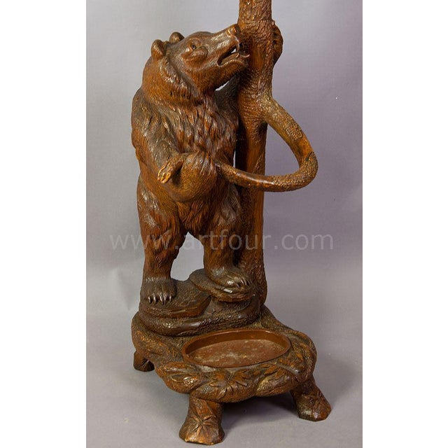 a handcarved wood bear hallstand. the mother bear looking upwards at her cub hanging in the branches. executed ca. 1900,...