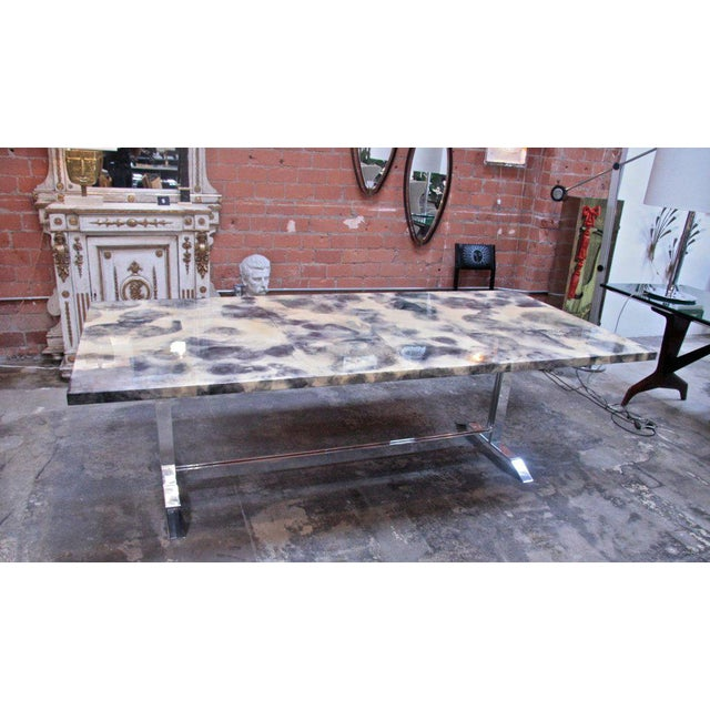 Swinging sexy stainless base dining table with treated parchment resin covered top. Dinner is served.