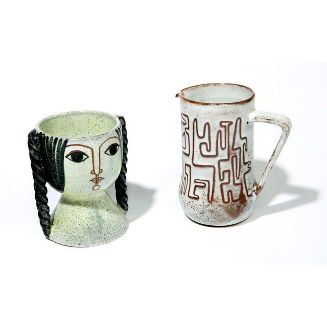 Two distinctive European vessels from the postwar Golden Age of studio pottery. The Woman's Head chalice, by Spanish...