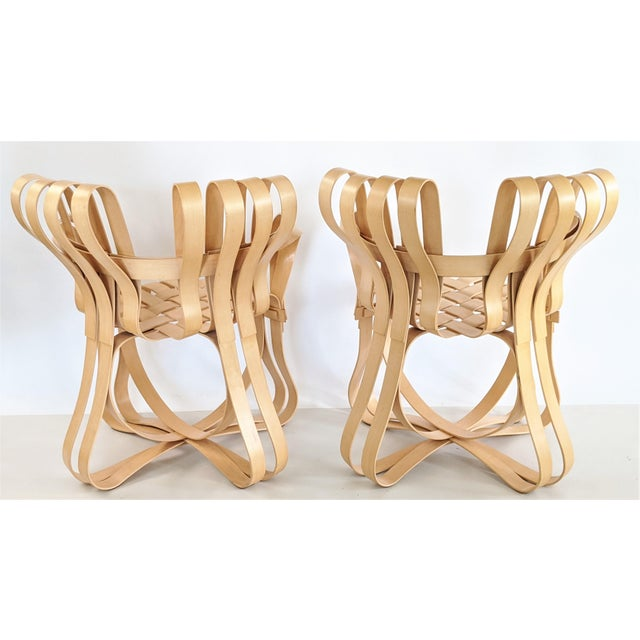 "Frank Gehry ""Cross Check Chairs"" for Knoll International. Ribbon design with white maple veneer strips creates a graceful..."