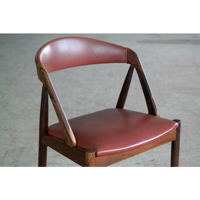 Kai Kristiansen Rosewood and Red Leather Model 31 Dining Chairs - Set of 5 For Sale In New York - Image 6 of 13