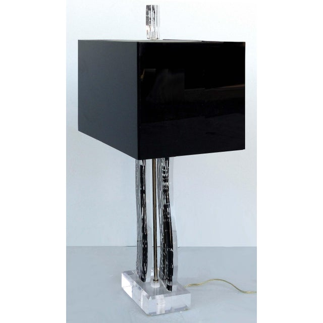 Offered for sale is a graphic mod acrylic and Lucite table lamp with lettering encased within the Lucite. The shade is...