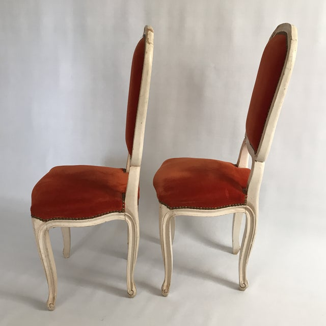 Pair of small vintage carved wood side or hall chairs with white or cream lacquered finish. Orange velvet upholstered...