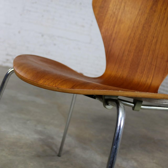 Pair of vintage MCM Series 7 Model 3107 molded teak chairs with chrome legs designed by Arne Jacobsen for Fritz Hansen in...