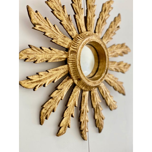 Mid century French sunburst mirror with original convex glass and gilt wood acanthus leaf motif. Matches larger acanthus...