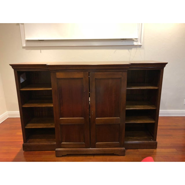 "Like-new TV armoire/bookcase has to go because of a family room remodel. Fits up to 40"" TV, with lockable side cabinets..."
