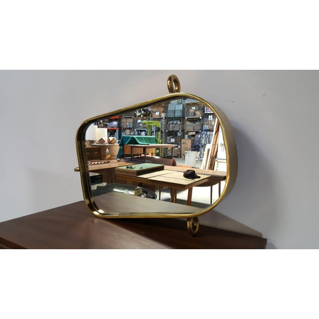 Custom Unique one-of-a kind solid brass nautical marine mirror. In excellent vintage condition. Mirror has two small...