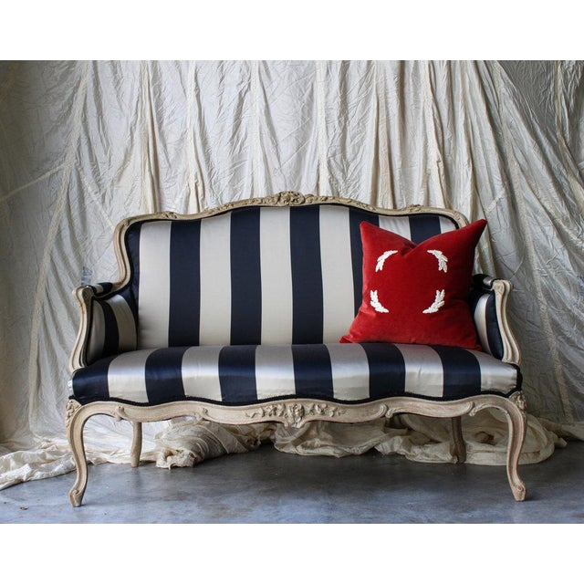 We found it in a fragile condition but long from gone! It has a beautiful natural stain and is paired with a wide stripe...