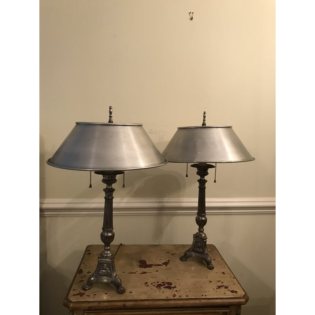 Pair silver Metal candle stick lamps Metal shades. No stamp of maker. Purchased 20 plus years ago at an Antique shop in...