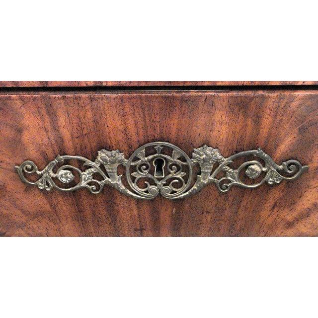 German Biedermeier (19th Cent) mahogany kneehole desk with bronze trim.