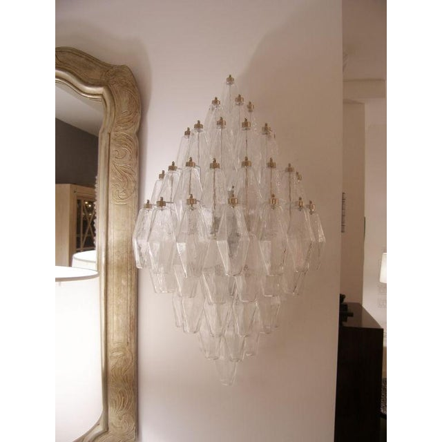 A pair of polyhedral shaped clear glass sconces on metal frames with nickel caps by Venini, Italy C.1970's