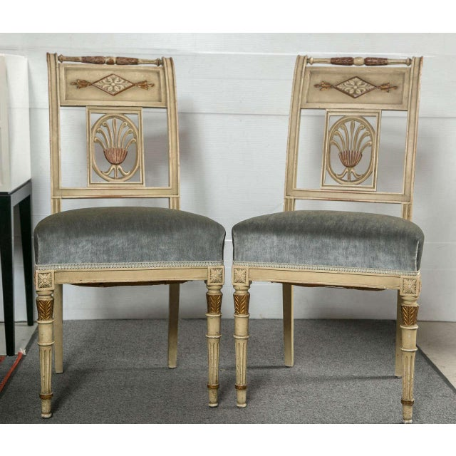 A fine set of six Hollywood Regency style dining chairs finely painted with gilt gold highlights. Each of these wonderful...