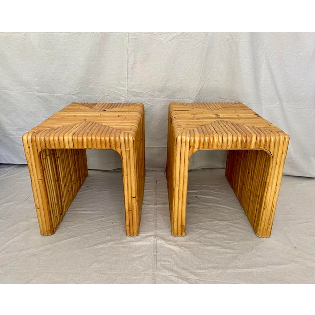 Vintage pair of split reed rattan side tables. Bent reed waterfall design. A solid, sturdy pair with the classic, natural...