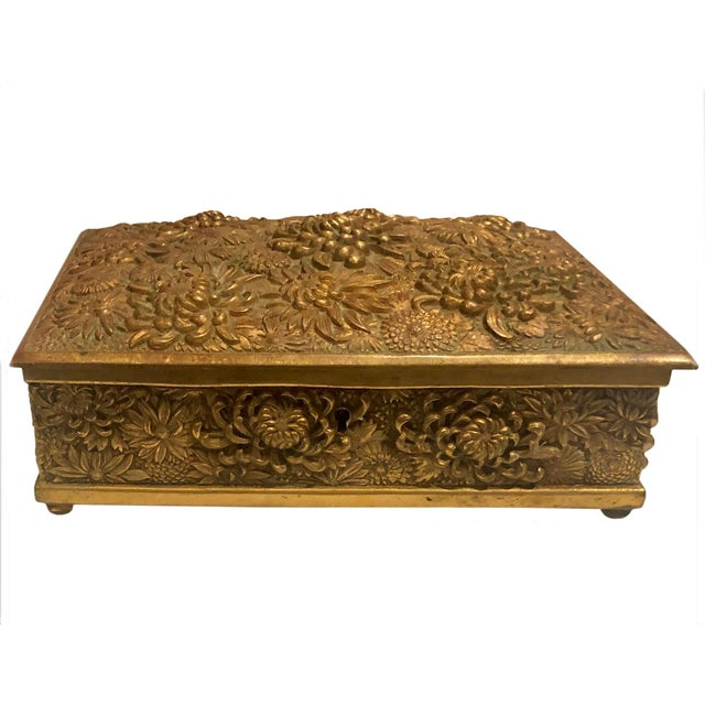 The antique repousse brass box is extremely high-quality the interior has red silk velvet I would say it is French made...