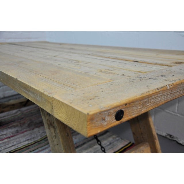 Salvaged Industrial Reclaimed Pine Wood Rustic Dining Table With Metal Elements For Sale - Image 12 of 13