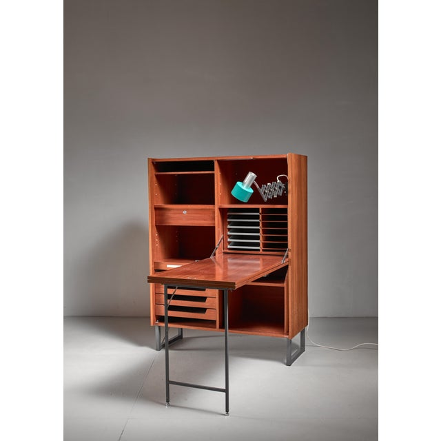 Home secretaire that easily folds up into a lockable cupboard. It has beautiful drawers and a bakelite pencil case, hidden...