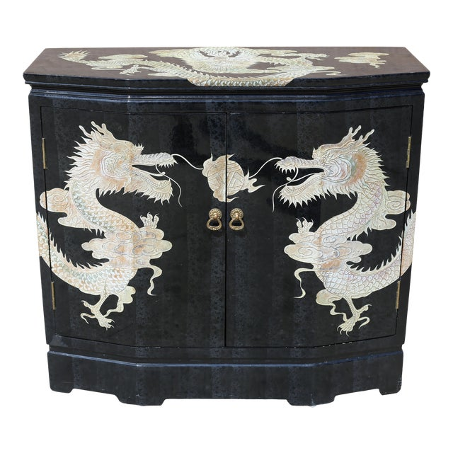 Vintage Chinoiserie Black Lacquered Cabinet With Carved Dragons For Sale