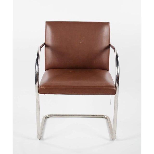 Bring Bauhaus into your house with this Brno Naugahyde and chrome arm chair designed by Ludwig Mies van der Rohe for Knoll...