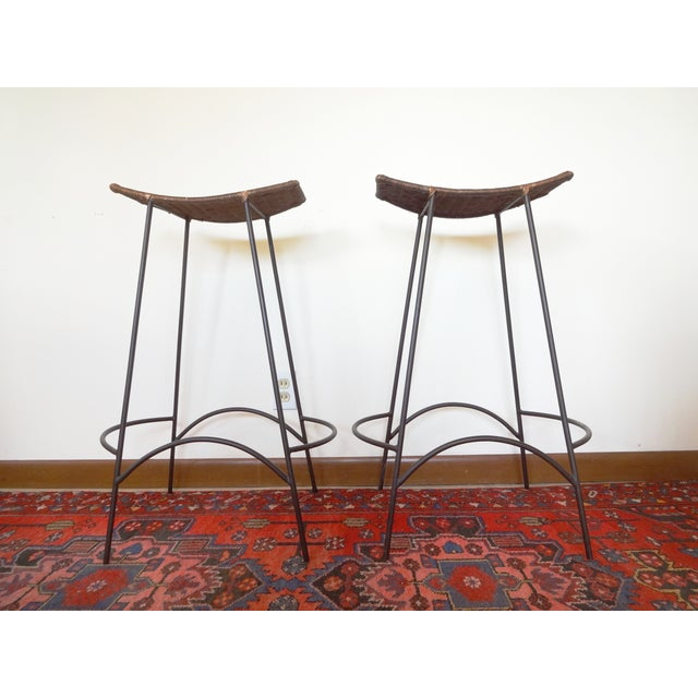 Set of two barstools, from the 1950s. Designed by Arthur Umanoff, for Raymor. Love the combination of the iron, with the...