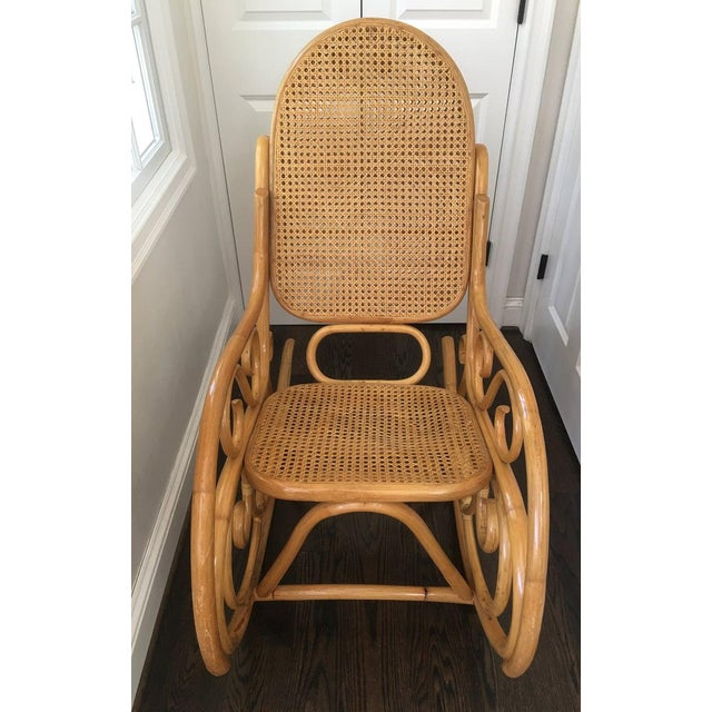 Beautiful vintage mid 20th Century bent bamboo rocking chair with caned wicker seat and double caned back. The chair...