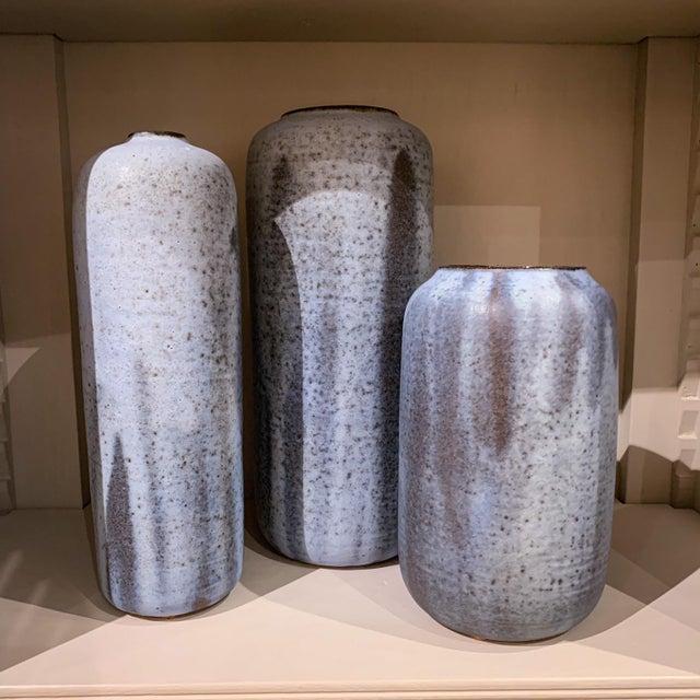 "Set of three handmade light blue matte stoneware vases by Laetitia DiGioia Size: Tallest: 5"" Diameter 12.75"" H Origin:..."