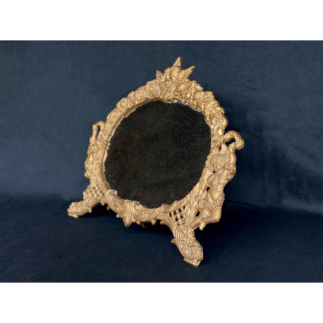 Rococo Vintage French Rococo Louis XV Gilded Brass Cherub Motif Oval Table Mirror For Sale - Image 3 of 10