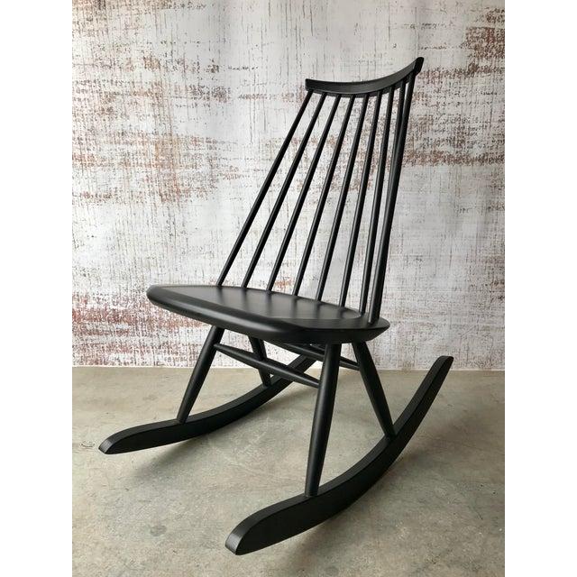 "Classic Scandinavian rocking chair in solid birch designed by Ilmari Tapiovaara for Artek Black lacquer finish 21.75"" W x..."