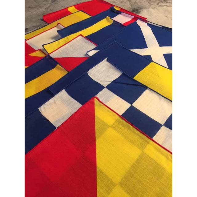 Crisp linen in bright red, yellow, blue and white Signal Flag patterns adds some fun to any happy hour, whether you are on...