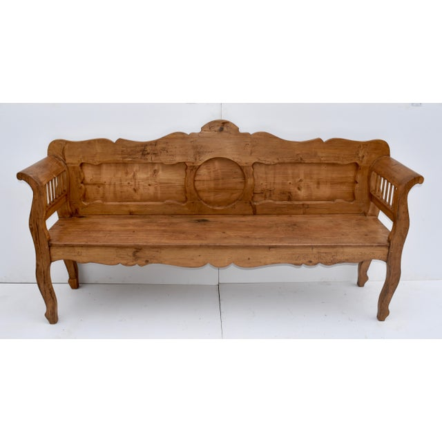 This is a most interesting and unusually decorative central European pine and oak bench. The back has a boldly scalloped...