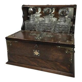 Antique Lates English Oak Tantalus - Set of 4 For Sale