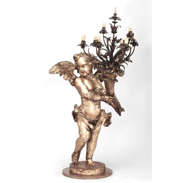 Pair of French Louis XV style (19th century) gilt cupid torchiere with wings holding cornucopia candelabra (SIMILAR to...