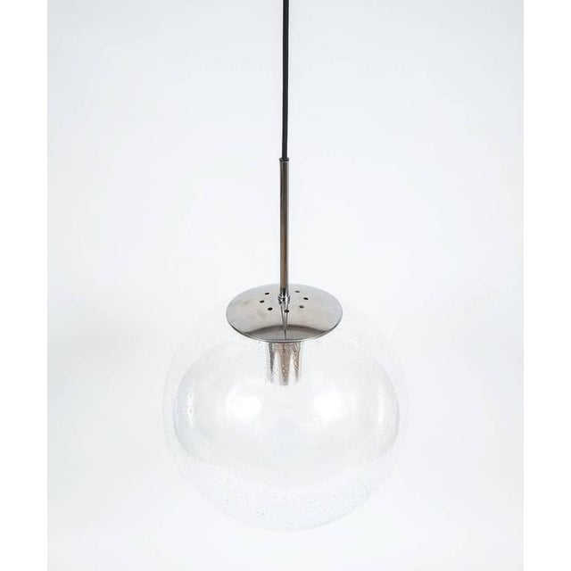 Glashütte Limburg Large Clear Glass Ball Pendant Light Lamps, circa 1960. Beautiful set of four (4) 16 inch globe pendants...