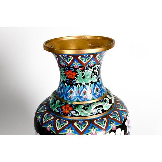 Large vintage gilt brass interior cloisonné exterior decorative vase / piece with floral design details. The vase is in...