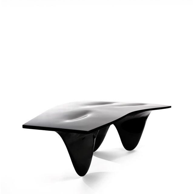 Glass-reinforced fiberglass, high gloss or satin matt lacquer, Black or White Established & Sons, a British brand,...