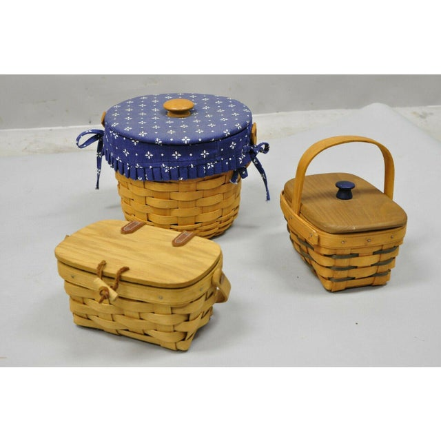 Vintage 1990s Longaberger Basket Lot Wine Berry Wall Pocket Lid Round - 9 Pieces. Item features lot includes various...