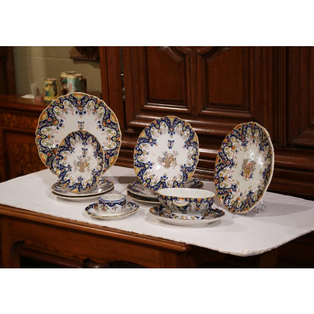 Colorful set of antique wall dishes from Rouen, France; handcrafted, circa 1880, the set includes two large wall hanging...