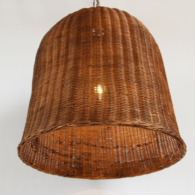 The wicker of this bell lantern has been stained a rich Coffee brown. Create a grouping with multiple lanterns or create a...