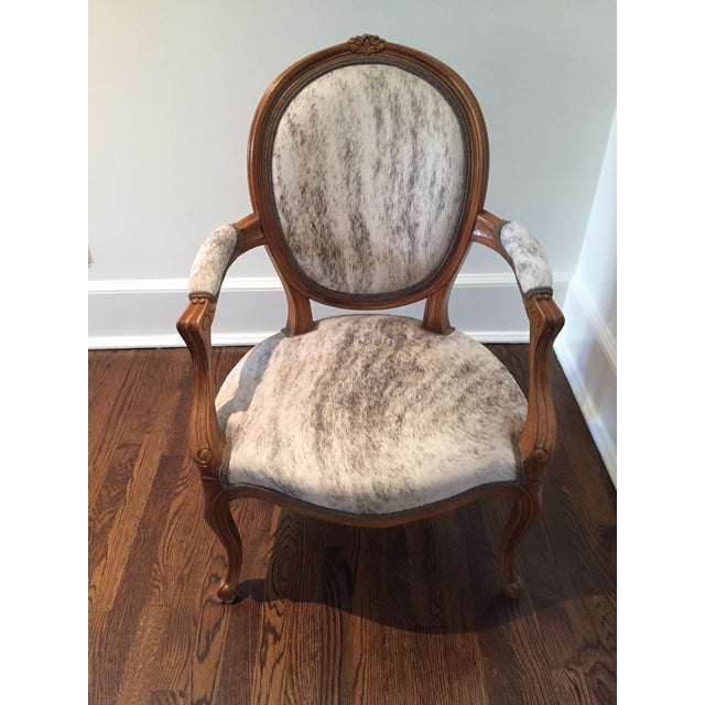 A set of his and hers antique bergere chairs, recovered in gorgeous neutral hide. In perfect condition. Used currently to...