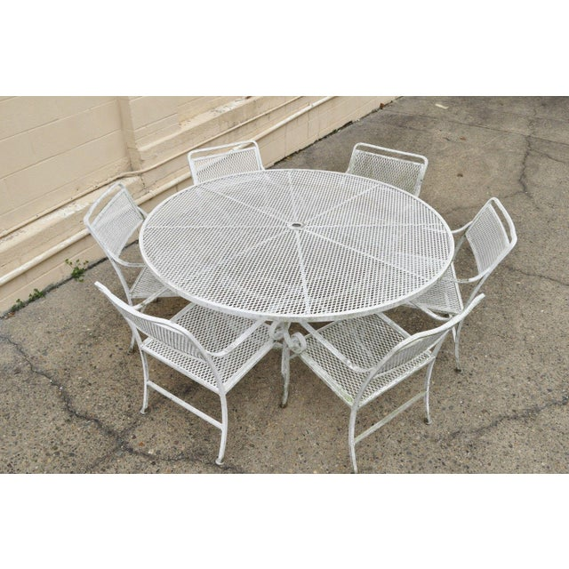 """Vintage 7 Piece Cast Aluminum Scrolling Metal Patio Dining Set Details: 60"""" round table with mesh top and umbrella hole, 6..."""