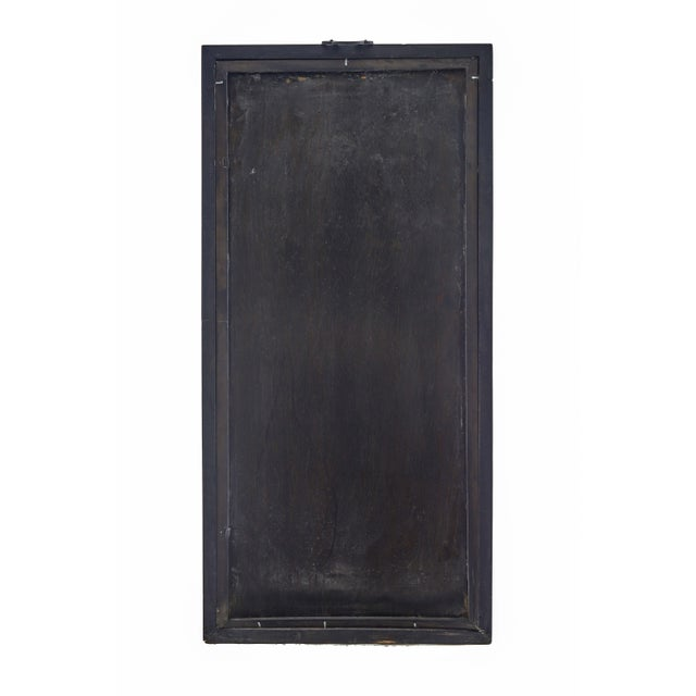 A unique piece of Chinese traditional art in a wooden Chinese frame. Artwork depicts a tall delicate tree entwined with...