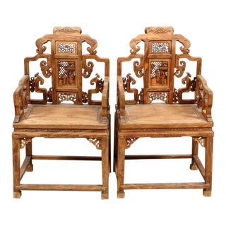 20th Century Chinese Natural Wood Carved Chairs - a Pair
