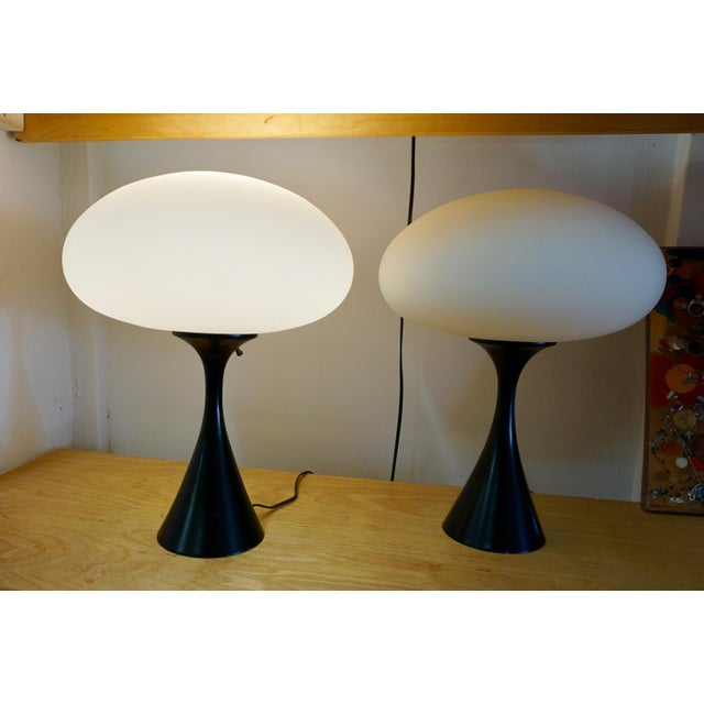Designed in the 60's by the Laurel Lamp Co.,New Jersey. Oval glass globes on sturdy,black enameled metal bases.