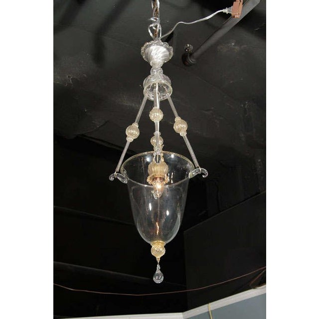 A charming Murano glass lantern with a clear centre glass jar hung by three clear and amber glass rods with lovely glass...
