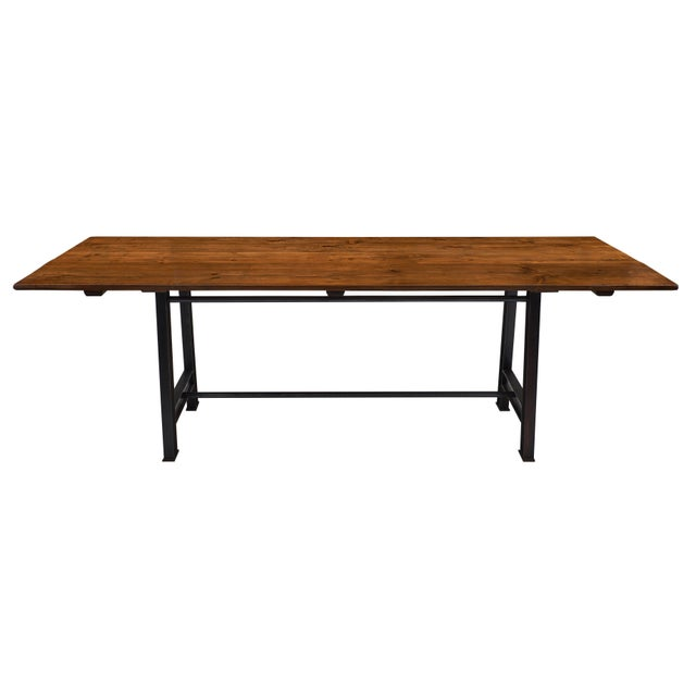 A bold 'atelier' French farm table featuring a patinated fir top on a strong steel base. We love the lines of this...